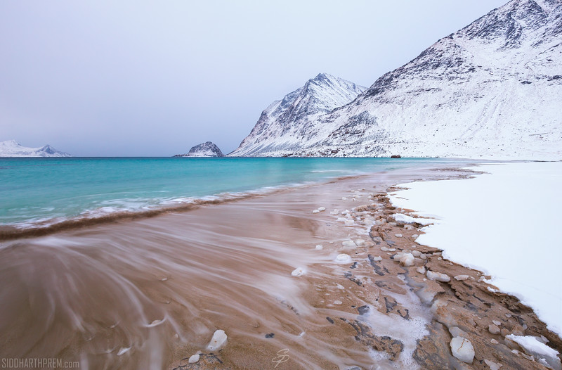 Waves wash away the snow