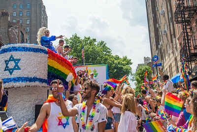 Drag Queen Alexis Michelle waves to people on the street from on top of the Israeli Delegation's float during the annual 2018 Pride Parade in New York City.