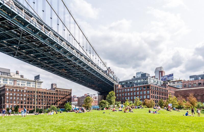 Sunbathers Under the Brooklyn Bridge