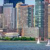 Sailboats Travel Along Lower Manhattan in the East River