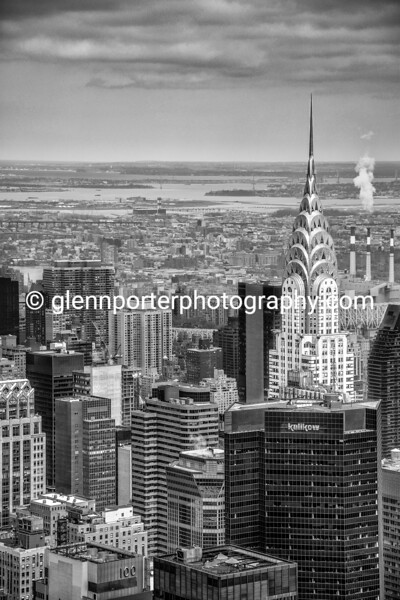 Chrysler Building, New York, black and white image - taken from the Empire State building. After spending an hour on top of the Empire State Building with flat lighting, we decided to leave, but on the way out, on the mid-level, I noticed the sun light just catching the Chrysler building.