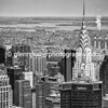 Chrysler Building, black and white image - taken from the Empire State building. After spending an hour on top of the Empire State Building with flat lighting, we decided to leave, but on the way out, on the mid-level, I noticed the sun light just catching the Chrysler building.