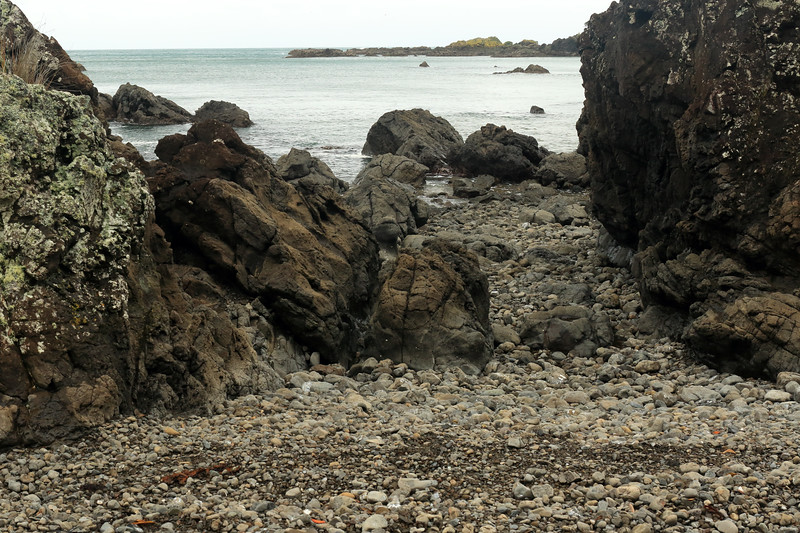 Late-ebb tide along volcanic basalt rock shoreline along the far northernmost area of the Raukumara Peninsula - beyond to the Tohora Pirau islets - Gisborne (East Cape) region.