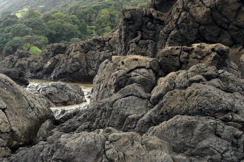 Volcanic basalt rock shoreline along the Mangaroa Range - the far northernmost area of the Raukumara Peninsula - Gisborne (East Cape) region.