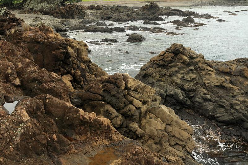 Tide pools along the volcanic rock shoreline during late-ebb tide - Raukumara Peninsula - Gisborne (East Cape) region.