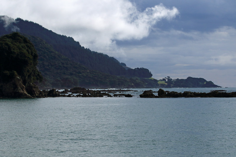From Maraehako Bay - to the eastern headland and mouth into Whanarua Bay, amongst the islets during late flood tide - with beyond Te Huka Island, seen just before the end of the headland slope - Bay of Plenty region.