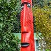 Modern Maori totem pole in a private garden near Thames, Coromandel