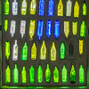 Glass bottles in the wall of the Kawakawa public toilets.