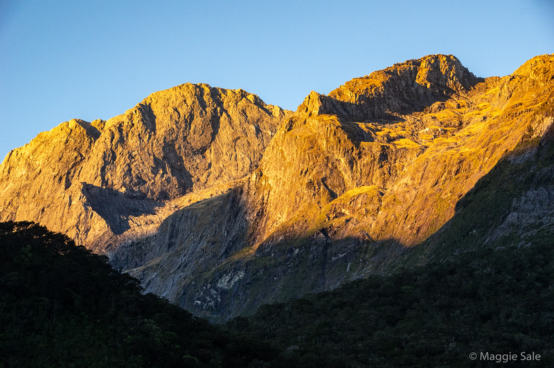 Evening light on the mountains near the shore.
