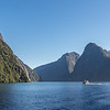 View from the shore at Milford Sound . Not a cloud in the sky - a rare occurrence on this normally wet west coast!