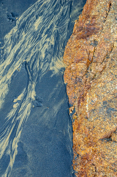 Sand pattern and rocks at Split Apple beach. Two toned sand on this beach.