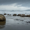 Moeraki Rocks on the east coast north of Dunedin. Strange round boulders spaced out along a beach which are covered at high tide. Fortunately visible when we were there!