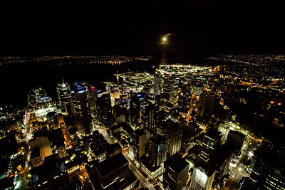 The nighttime view of Auckland from atop the tallest building by far in the city and apparently the tallest free standing structure in the southern hemisphere.