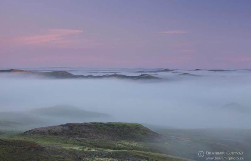Dense morning fog in the East Block badlands. Grasslands National Park, Saskatchewan