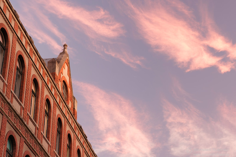 View of a brick building in downtown Zagreb at sunset.