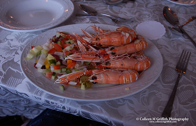 "Freshest Langoustines  © 2005 Colleen M. Griffith. All Rights Reserved.  This material may not be published, broadcast, modified, or redistributed without written agreement with the creator.  This image is registered with the US Copyright Office.   www.colleenmgriffith.com www.facebook.com/colleen.griffith  I asked the server where these Langoustines were from - she looked out the window next to my table and pointed to the dock on the water just below us.  Guess they were about as ""local"" as they could possibly be!  Isle of Skye, Scotland"