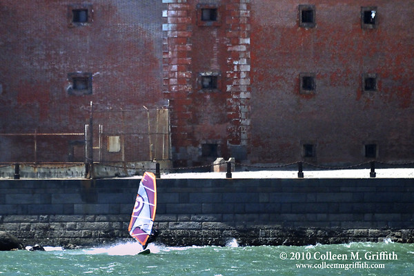"""Windsurfing Near Fort Point, San Francisco Bay California<br /> ©  2010 Colleen M. Griffith. All Rights Reserved.  This material may not be published, broadcast, modified, or redistributed in any way without written agreement with the creator.  This image is registered with the US Copyright Office.<br />  <a href=""""http://www.colleenmgriffith.com"""">http://www.colleenmgriffith.com</a><br />  <a href=""""http://www.facebook.com/colleen.griffith"""">http://www.facebook.com/colleen.griffith</a>"""