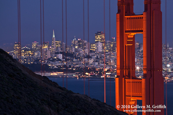 """Two San Francisco Icons At Night<br /> ©  2010 Colleen M. Griffith. All Rights Reserved.  This material may not be published, broadcast, modified, or redistributed in any way without written agreement with the creator.  This image is registered with the US Copyright Office.<br />  <a href=""""http://www.colleenmgriffith.com"""">http://www.colleenmgriffith.com</a><br />  <a href=""""http://www.facebook.com/colleen.griffith"""">http://www.facebook.com/colleen.griffith</a><br /> <br /> TransAmerica Building framed by the Golden Gate Bridge at night. You can see more of my San Francisco photos, by going to my San Francisco gallery:  <a href=""""http://www.colleenmgriffith.com/Galleries/San-Francisco/San-Francisco"""">http://www.colleenmgriffith.com/Galleries/San-Francisco/San-Francisco</a>"""