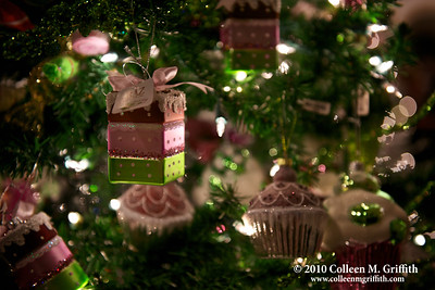 Delectable Decorations ©  2010 Colleen M. Griffith. All Rights Reserved.  This material may not be published, broadcast, modified, or redistributed in any way without written agreement with the creator.  This image is registered with the US Copyright Office.  www.colleenmgriffith.com www.facebook.com/colleen.griffith  This is the third photo in my Holiday Cheer series.  It was also captured at the Filoli Mansion - an historic site of the National Trust for Historic Preservation and one of the finest remaining country estates of the early 20th century.   I love how they change up the decorations at the mansion every year.  This tree was so creative - all the ornaments on it were colorful desserts.  They even had tables nearby with pastry dessert towers filled with these ornaments - if you weren't careful, you might just bite into them, they looked so yummy. :D Posted 2 December 2010.