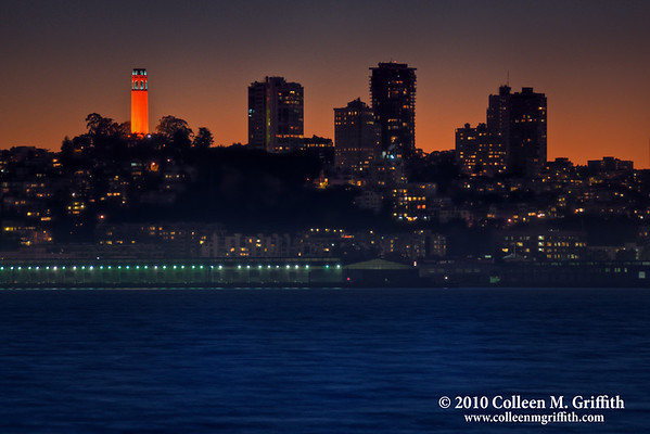 """In Honor of the San Francisco Giants<br /> ©  2010 Colleen M. Griffith. All Rights Reserved.  This material may not be published, broadcast, modified, or redistributed in any way without written agreement with the creator.  This image is registered with the US Copyright Office.<br />  <a href=""""http://www.colleenmgriffith.com"""">http://www.colleenmgriffith.com</a><br />  <a href=""""http://www.facebook.com/colleen.griffith"""">http://www.facebook.com/colleen.griffith</a><br /> <br /> In honor of the San Francisco Giants winning the World Series, the Coit Tower was lit up in Giants colors.  This photo of the city skyline was captured the night after their win and the day before they were welcomed home to massive crowds in the city.  Congratulations to a wonderful team.  The weather even honored their win with beautiful, warm, sunny (no fog) skies and a magnificent orange sunset.  There are typically only about a dozen days (or something like that) of no fog in the city each year, so what a treat this was!  I also posted a slightly lightened version of this shot - here is a direct link to that version: <a href=""""http://www.colleenmgriffith.com/Galleries/New/New-Photo-Daily/13407757_C6nwm#1078703764_AfB3f"""">http://www.colleenmgriffith.com/Galleries/New/New-Photo-Daily/13407757_C6nwm#1078703764_AfB3f</a><br /> <br /> You can see more of my San Francisco Shots, by going to my San Francisco gallery:  <a href=""""http://www.colleenmgriffith.com/Galleries/San-Francisco/San-Francisco"""">http://www.colleenmgriffith.com/Galleries/San-Francisco/San-Francisco</a>  <br /> <br /> Posted 04 November 2010."""