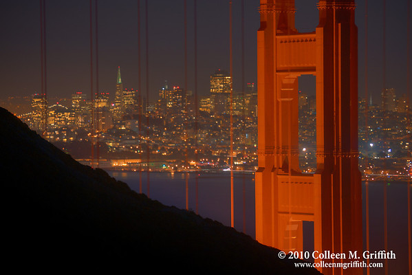 """Two San Francisco Icons<br /> ©  2010 Colleen M. Griffith. All Rights Reserved.  This material may not be published, broadcast, modified, or redistributed in any way without written agreement with the creator.  This image is registered with the US Copyright Office.<br />  <a href=""""http://www.colleenmgriffith.com"""">http://www.colleenmgriffith.com</a><br />  <a href=""""http://www.facebook.com/colleen.griffith"""">http://www.facebook.com/colleen.griffith</a><br /> <br /> TransAmerica Building framed by the Golden Gate Bridge.  You can see more of my San Francisco photos, by going to my San Francisco gallery:  <a href=""""http://www.colleenmgriffith.com/Galleries/San-Francisco/San-Francisco"""">http://www.colleenmgriffith.com/Galleries/San-Francisco/San-Francisco</a>"""