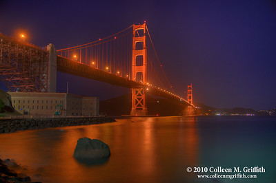 """The Golden Gate ©  2010 Colleen M. Griffith. All Rights Reserved.  This material may not be published, broadcast, modified, or redistributed in any way without written agreement with the creator.  This image is registered with the US Copyright Office. www.colleenmgriffith.com www.facebook.com/colleen.griffith  To see a version of this photo where I have removed the Green & White construction equipment (""""Cherry Pickers"""") parked next to the building, and lightened the overall photo   CLICK HERE  You can see more of my San Francisco photos, by going to my San Francisco gallery: www.colleenmgriffith.com/Galleries/San-Francisco/San-Francisco"""