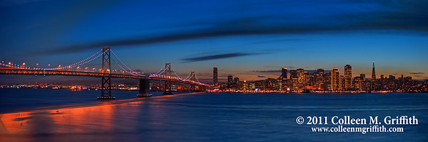 """San Francisco Twilight ©  2011 Colleen M. Griffith. All Rights Reserved. This material may not be published, broadcast, modified, or redistributed  without written agreement with the creator.  This image is registered with the US Copyright Office. <a href=""""http://www.facebook.com/colleen.griffith"""">Friend Colleen on Facebook</a>  This photo captures the special city lights that are visible only during the holiday season.  This photo will print well in an 10x30 or 12x36 inch format.  You can find additional cropped versions of this photo in my Panoramics Gallery:  www.colleenmgriffith.com/Galleries/California/Panoramics  You can see more of my city shots in my San Francisco gallery: www.colleenmgriffith.com/Galleries/California/San-Francisco"""