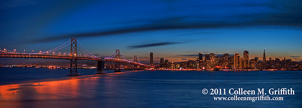San Francisco Skyline at Twilight ©  2011 Colleen M. Griffith. All Rights Reserved. This material may not be published, broadcast, modified, or redistributed  without written agreement with the creator.  This image is registered with the US Copyright Office. www.colleenmgriffith.com www.facebook.com/colleen.griffith  This photo captures the special city lights that are visible only during the holiday season.  This photo would need to be cropped in order to print it from this site.  You can crop it yourself during the check-out process, or you can find pre-cropped versions of this photo in my Panoramics Gallery:  www.colleenmgriffith.com/Galleries/San-Francisco/Panoramics . As always, you can purchase a digital copy and print it at a different print lab.   You can see more of my city shots in my San Francisco gallery: www.colleenmgriffith.com/Galleries/San-Francisco/San-Francisco