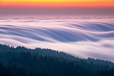 Heavy summer fog flowing over Mount Tam