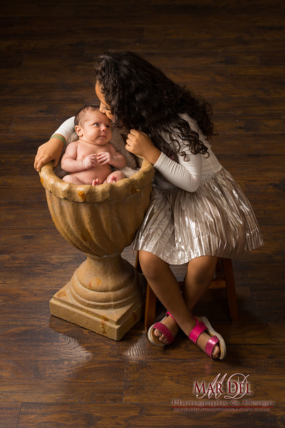 sister kissing baby in picture