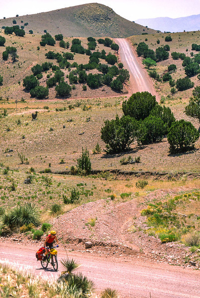 Cyclist on NM 107, Sibley's retreat route around Fort Craig - 7 - 72 ppi