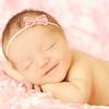 smiling pink newborn