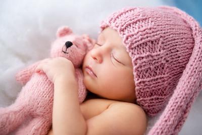 Newborn baby in clouds