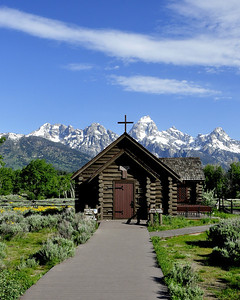 """Chapel of Transfiguration"" with the Grand Teton Mts in background. Chapel is still used every Sunday and for wedding."