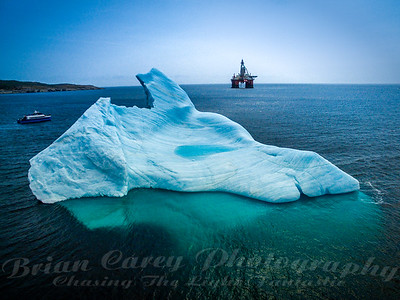 Iceberg and West Hercules Oil Rig in Bay Bulls Harbour