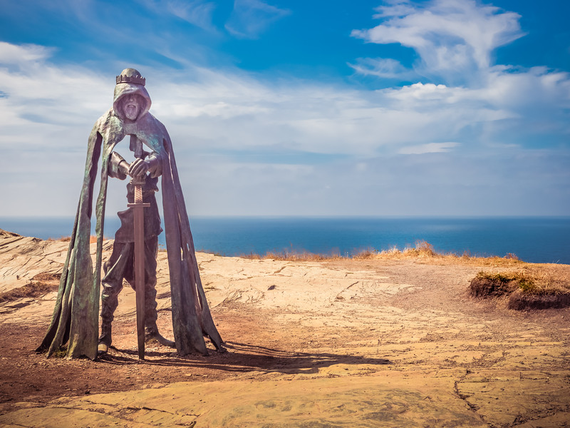 Arthur,  Created by artist Rubin Eynon, this eight foot statue watches over his realm, the land ahead of him, and the Atlantic sea beyond.