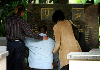 12 JUN 2006 TOWNSVILLE, QLD - One of only two survivors on Blackhawk one John Fraser remembers his mates along with his wife Natalie and brother David - 10 yr memorial for the Blackhawk crash.  18 soldiers from the SAS and 5 Aviation Regiment died on 12 June 1996 when 2 Blackhawk helicopters collided during night exercises at High Range training facility west of Townsville - PHOTO: CAMERON LAIRD (Ph: 0418 238811)