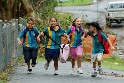 27 MAR 2006 INNISFAIL, QLD - Re-opening of Innisfail State School.  Students (from left) Devon Masina (grade 2), Janaeh Appleby (grade 3), Shannon Green (grade 2), and Jayden Rye (grade 3) celebrate a return to their school - PHOTO: CAMERON LAIRD (Ph: 0418238811)