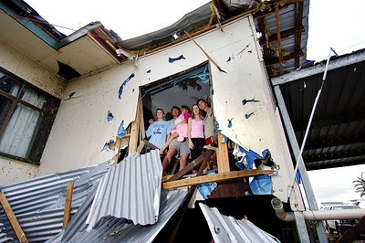 23 MAR 2006 INNISFAIL, QLD - Cyclone Larry damage in North Qld.  Kim and Wally Glatthor with children (from left) Zak, 12, Teshia, 8, and Hanna, 11 stand in the remains of their Innisfail home - PHOTO: CAMERON LAIRD (Ph: 0418238811)