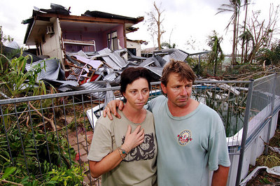 23 MAR 2006 INNISFAIL, QLD - Cyclone Larry damage in North Qld.  Kim and Wally Glatthor stand near the remains of their Innisfail home - PHOTO: CAMERON LAIRD (Ph: 0418238811)