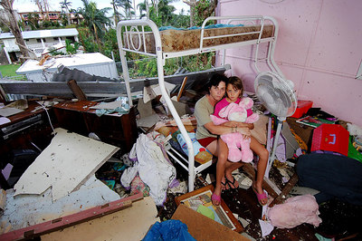23 MAR 2006 INNISFAIL, QLD - Cyclone Larry damage in North Qld.  Kim Glatthor and daughter Teshia, 8 sit in what remains of Teshia's room - PHOTO: CAMERON LAIRD (Ph: 0418238811)