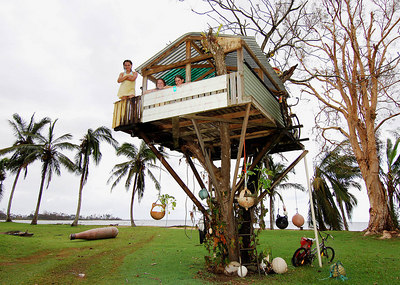 27 MAR 2006 INNISFAIL, QLD - A coastal cubby-house that faced the full force of Cyclone Larry remained unscathed while hundreds of homes around the district are condemned.  Friends (from left) Kirilea Gray, 11, Fran Wood, 12, and Alicia Smith, 11 in their childhood retreat - PHOTO: CAMERON LAIRD (Ph: 0418238811)