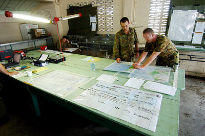23 MAR 2006 INNISFAIL, QLD - Cyclone Larry.  Troops from 3CSSB (3rd Combat Service Support Battalion) at their Innisfail Showgrounds headquarters - PHOTO: CAMERON LAIRD (Ph: 0418238811)