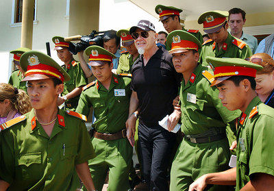 02 MAR 2006 VUNG TAU, VIETNAM - Gary Glitter outside court for the first day of his trial in Vung Tau, Vietnam - PHOTO: CAMERON LAIRD (Ph: +61 418238811)