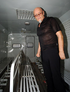 03 MAR 2006 VUNG TAU, VIETNAM - Gary Glitter inside a prison van after receiving a three year sentence at his trial in Vung Tau, Vietnam - PHOTO: CAMERON LAIRD (Ph: +61 418238811)