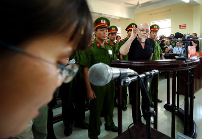 03 MAR 2006 VUNG TAU, VIETNAM - Gary Glitter listens as his three year sentence is read out on the final day of his trial in Vung Tau, Vietnam - PHOTO: CAMERON LAIRD (Ph: +61 418238811)
