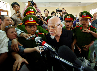 03 MAR 2006 VUNG TAU, VIETNAM - Gary Glitter reacts after he is handed a three year sentence on the final day of his trial in Vung Tau, Vietnam - PHOTO: CAMERON LAIRD (Ph: +61 418238811)