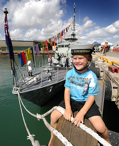 22 APR 2007 TOWNSVILLE, QLD - Kyle Wilkinson, 5, and the HMAS Townsville berthed at Townsville Port - PHOTO: CAMERON LAIRD (Ph: 0418 238811)