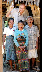 "04 MAY 2005 BEANGIUNG VILLAGE, FLORES, INDONESIA - Daily Mail journalist Richard Shears (6' 1"") with Juliana Mia, 55, Martina Nguwul, 65, and Johannes Jerahi, 65 at the entrance to their family hut.  They believe they are descendants of ""The Hobbit"", a skeleton of a tiny woman who lived in a cave in the area 18,000 years ago - PHOTO: CAMERON LAIRD"