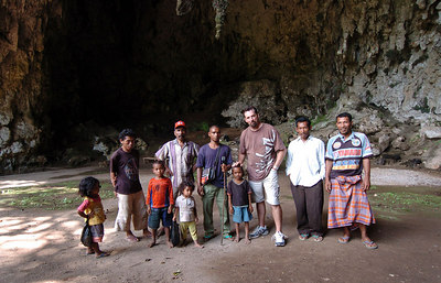 "04 MAY 2005 FLORES, INDONESIA - Daily Mail photographer Cameron Laird in the ""Hobbit's Cave"" with villagers from nearby - PHOTO: CAMERON LAIRD"